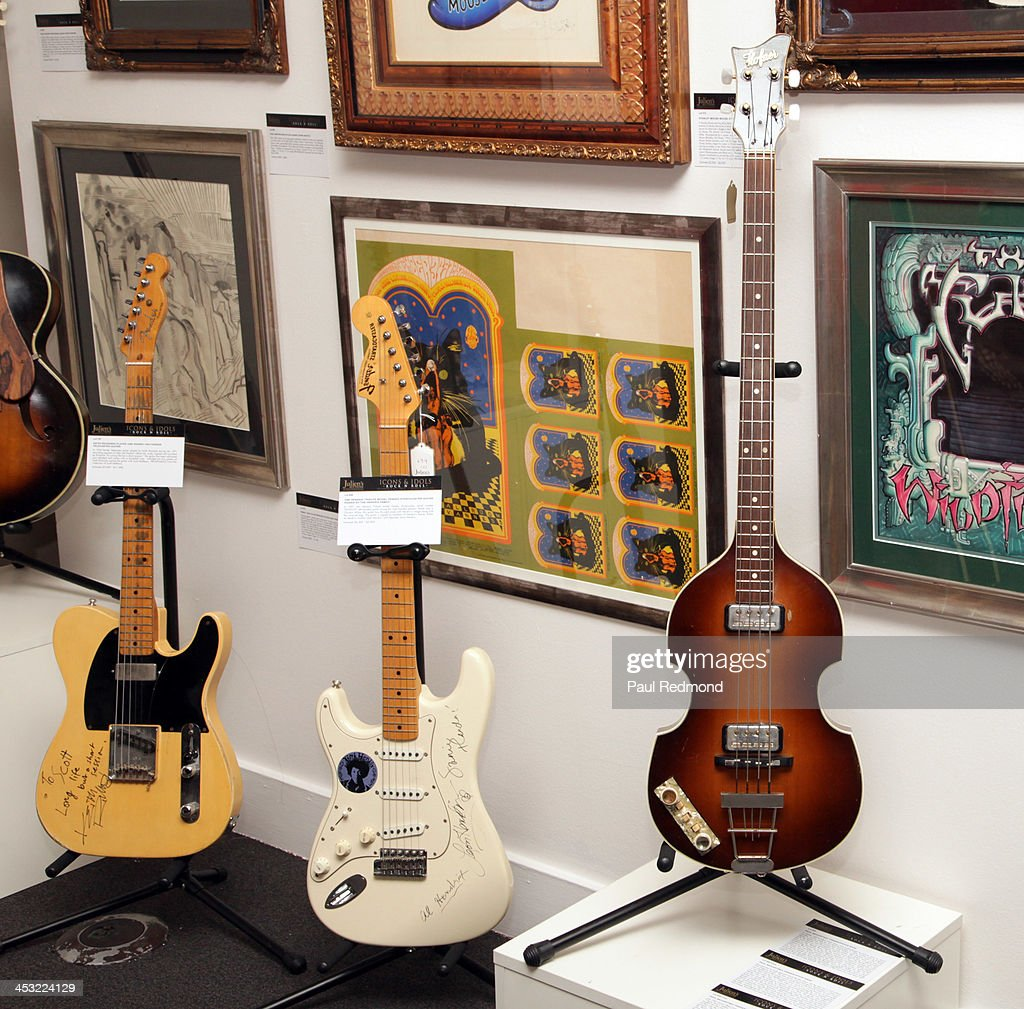 A guitar autographed by Keith Richards, a guitar autographed by the family of musucian Jimi Hendrix and a bass played by musician Paul McCartney at Julien's Auctions present The Trilogy Collection: Props and Costumes from Middle Earth, Street Art Auction and Icons and Idols: Rock n' Roll Memorabilia at Julien's Gallery on December 2, 2013 in Beverly Hills, California.
