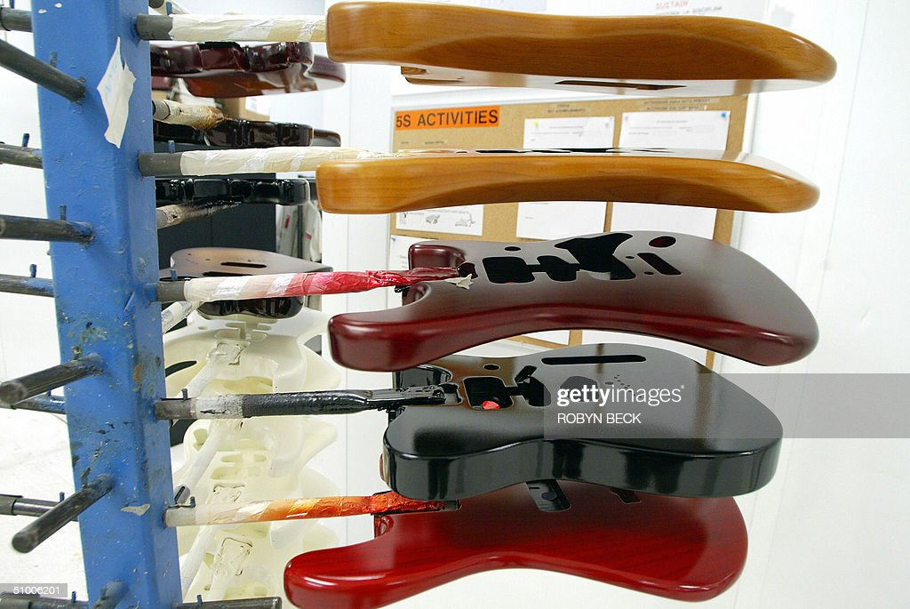 Guitar bodies are dried after painting at the Fender manufacturing facility in Corona California 28 June 2004 The sainted grandfather of electric...