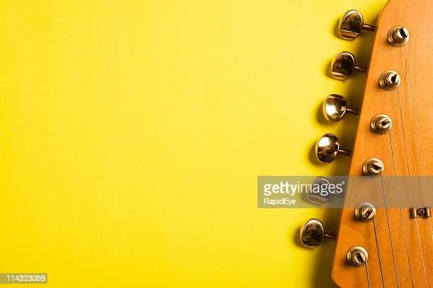 Guitar headstock on yellow