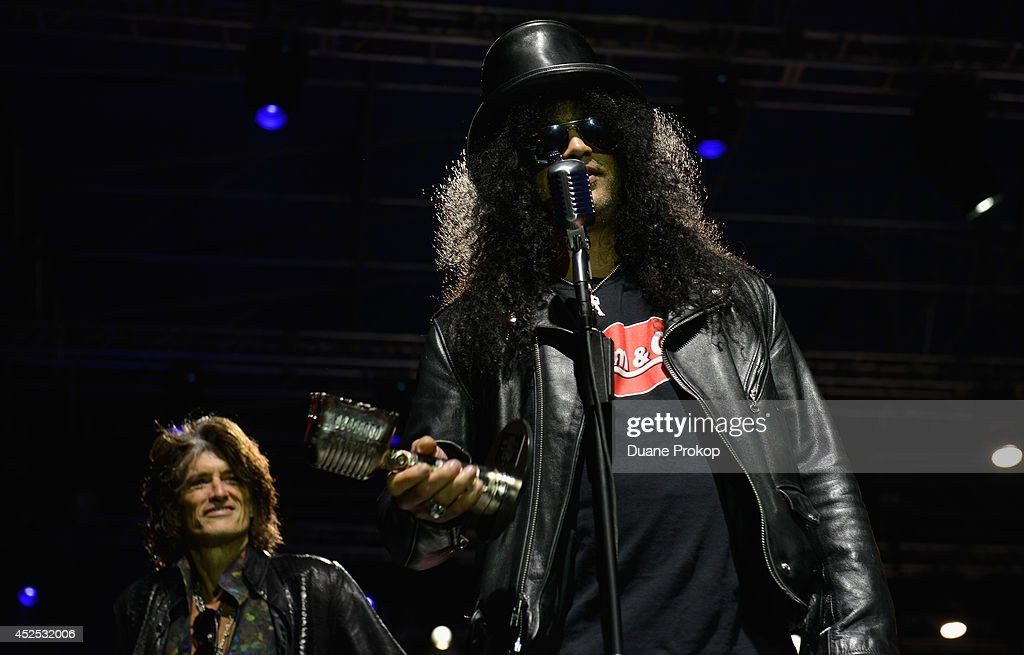 AP Guitar Legend Award winner Slash with award presenter Joe Perry of Aerosmith in the background at the 2014 Gibson Brands AP Music Awards at the Rock and Roll Hall of Fame and Museum on July 21, 2014 in Cleveland, Ohio.