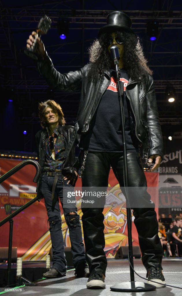 AP Guitar Legend Award winner Slash with award presenter <a gi-track='captionPersonalityLinkClicked' href=/galleries/search?phrase=Joe+Perry+-+Musician&family=editorial&specificpeople=13600677 ng-click='$event.stopPropagation()'>Joe Perry</a> of Aerosmith in the background at the 2014 Gibson Brands AP Music Awards at the Rock and Roll Hall of Fame and Museum on July 21, 2014 in Cleveland, Ohio.