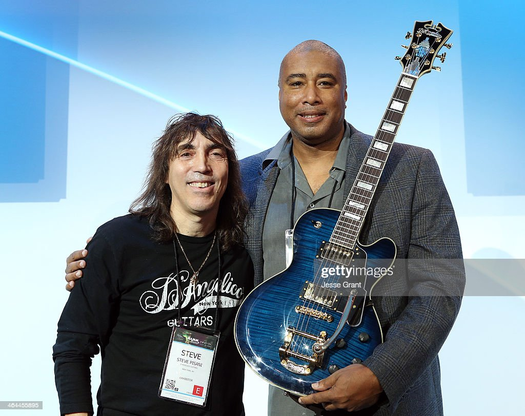 Guitar Maker Steve Pisani and Baseball Player <a gi-track='captionPersonalityLinkClicked' href=/galleries/search?phrase=Bernie+Williams&family=editorial&specificpeople=175814 ng-click='$event.stopPropagation()'>Bernie Williams</a> attend the 2014 National Association of Music Merchants show media preview day at the Anaheim Convention Center on January 22, 2014 in Anaheim, California.