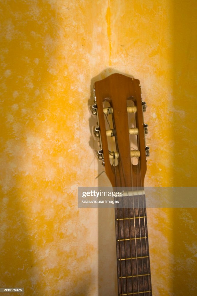 Guitar Neck Leaning Against Wall