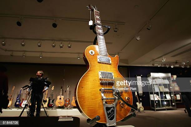A guitar once owned and used by Keith Richards of the Rolling Stones stands on display at Christie's December 10 2004 in New York City Christie's in...