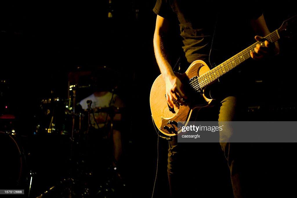 guitar player close up at a rock show : Stock Photo