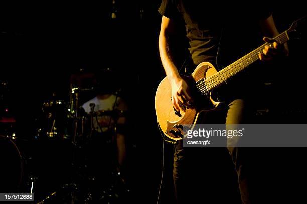 Guitarrista Plano aproximado em um show de rock