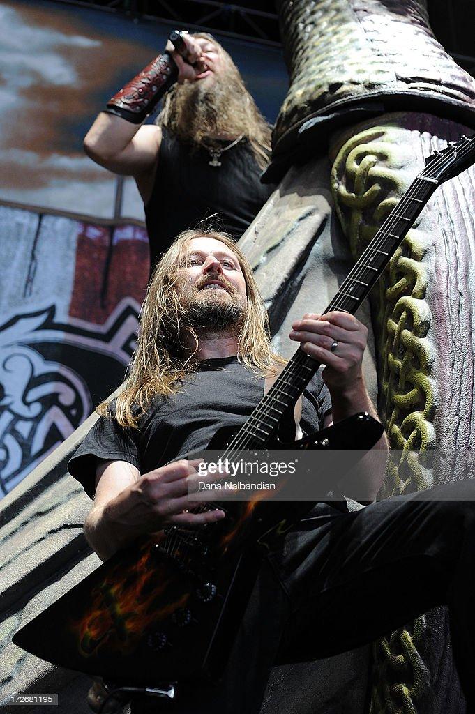 Guitar player Johan Soderberg and singer Johan Hegg of Amon Amarth performs at White River Amphitheater on July 3, 2013 in Auburn, Washington.