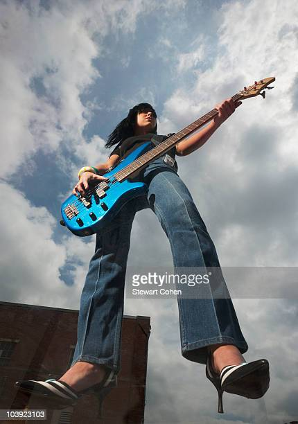 Guitar player suspended in the air