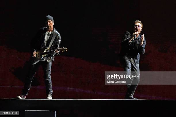 Guitar player The Edge and Singer Bono of the band U2 perform during U2 'Joshua Tree Tour 2017' at MetLife Stadium on June 28 2017 in East Rutherford...
