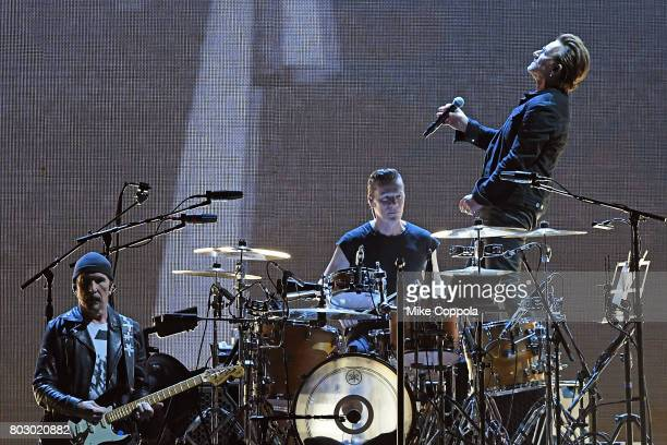 Guitar player The Edge Drummer Larry Mullen Jr and Singer Bono of the band U2 perform during U2 'Joshua Tree Tour 2017' at MetLife Stadium on June 28...