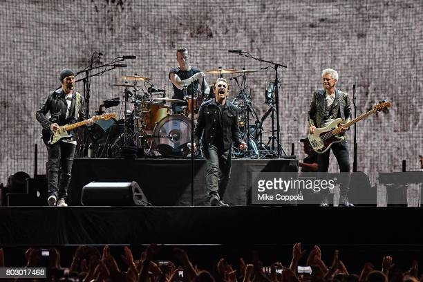 Guitar player The Edge Drummer Larry Mullen Jr Singer Bono and Bass player Adam Clayton of the band U2 perform during U2 'Joshua Tree Tour 2017' at...