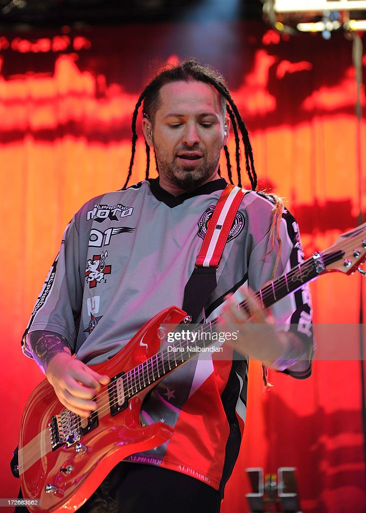 <Guitar player Zoltan Bathory of Five Finger Death Punch performs at White River Amphitheater on July 3, 2013 in Auburn, Washington.