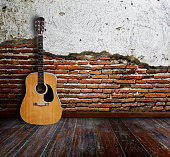 Guitar in grunge room.