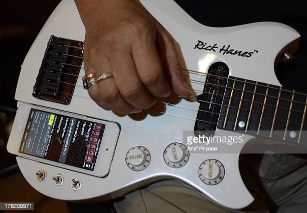 A guitar that works with an iPhone at the Rick Hanes guitar factory Rick Hanes guitars from Sidoarjo have been named as Guitar of the Year 2012 by...