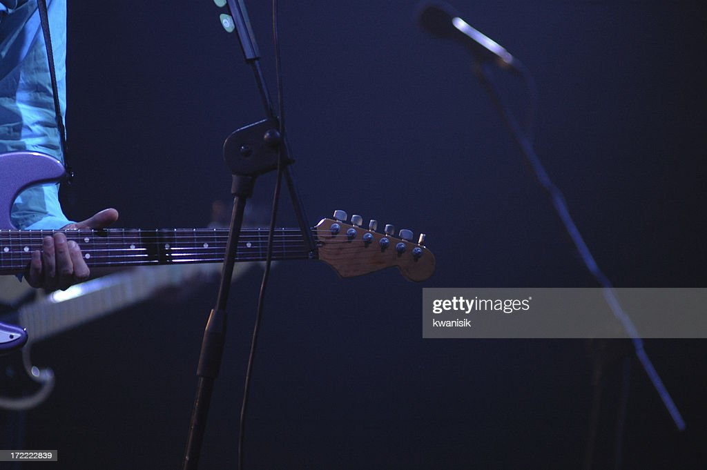 'guitar,and guitarist on the stage'