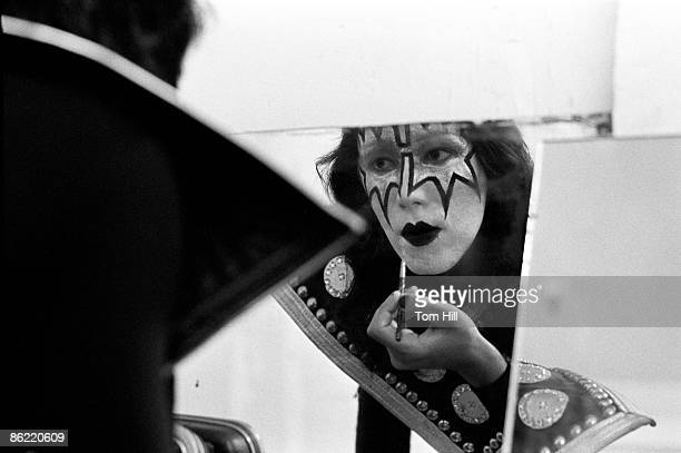 ATLANTA GA July 18 Guitarist Ace Frehley of the band Kiss puts the finishing touches on his makeup in the dressing room before performing at Alex...