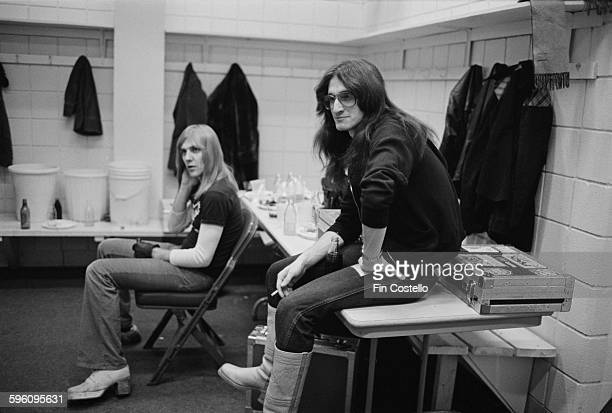 Guitarist Alex Lifeson and bassist Geddy Lee of Canadian progressive rock group Rush backstage at the Civic Center in Springfield Massachusetts...