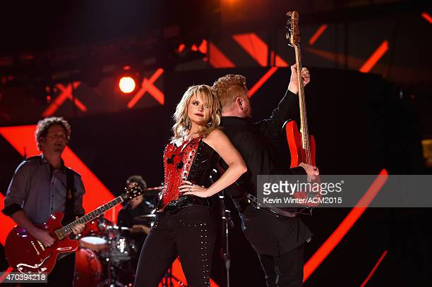 Guitarist Alex Weeden honoree Miranda Lambert and bassist Aden Bubeck perform onstage during the 50th Academy of Country Music Awards at ATT Stadium...
