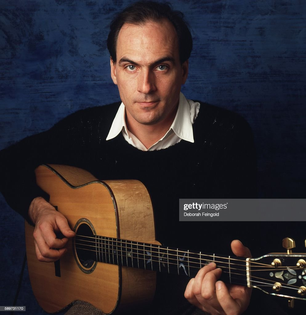 Guitarist and singer James Taylor posing in his apartment in January 1986 in New York City, New York.