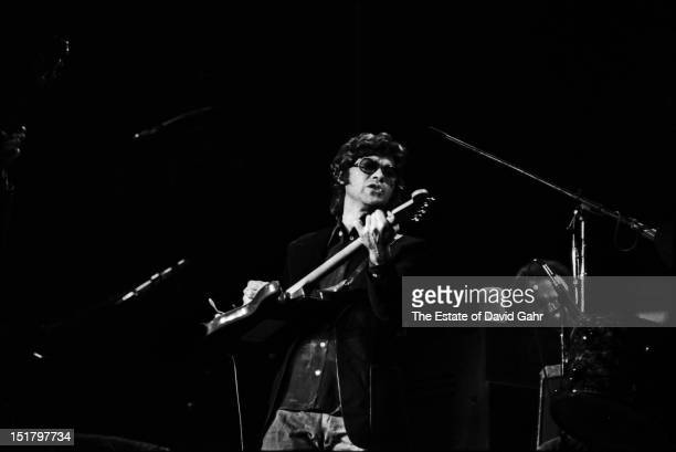 Guitarist and songwriter and founding member of The Band Robbie Robertson performs on January 30 1974 at Madison Square Garden in New York City New...