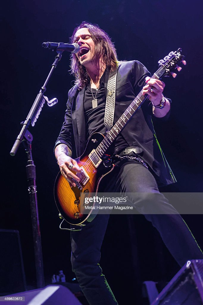 Guitarist and vocalist Myles Kennedy of American hard rock group Alter Bridge performing live on stage at Wembley Arena, on October 18, 2013.