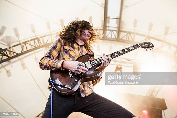 Guitarist and vocalist Thomas Erak of American hard rock group The Fall Of Troy performing live on stage at ArcTanGent Festival in Somerset on August...
