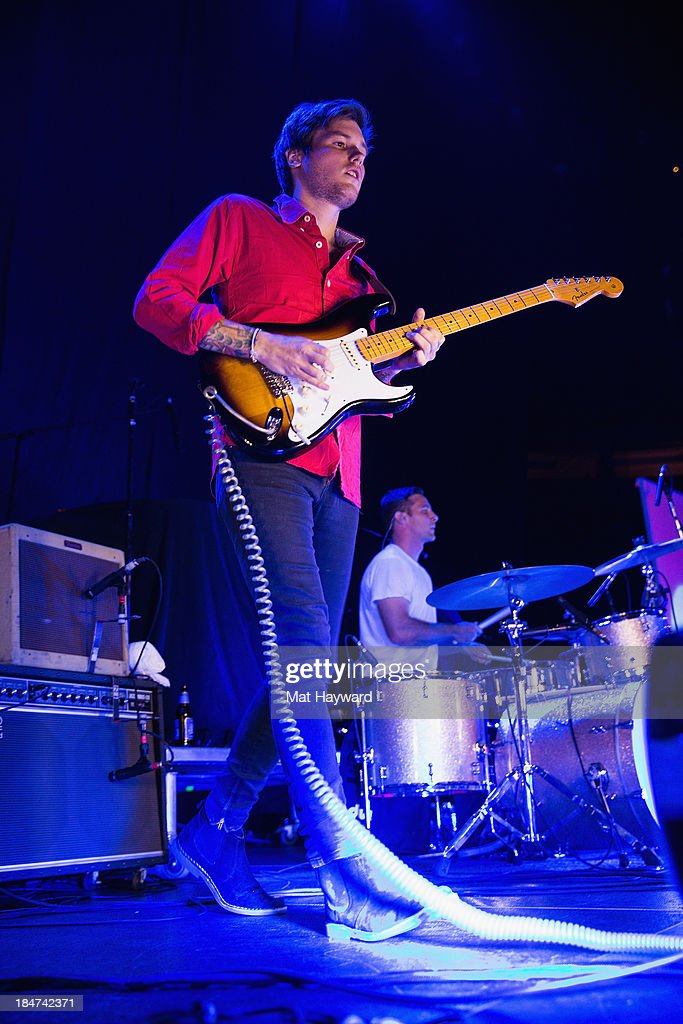 Guitarist Andrew Richards of Hellogoodbye performs on stage at Key Arena on October 15, 2013 in Seattle, Washington.