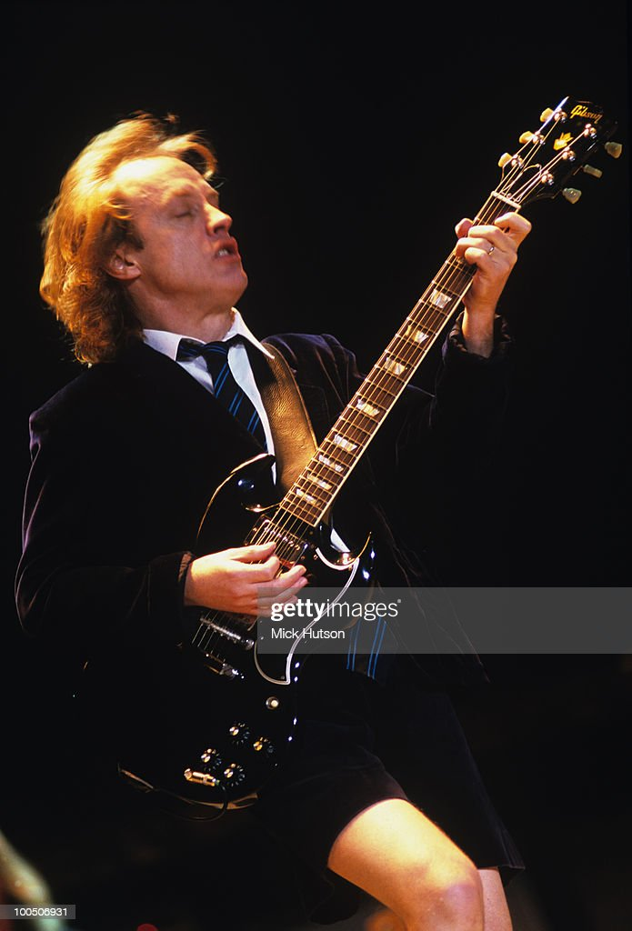 Guitarist Angus Young of AC/DC performs on stage at Wembley Arena in London, England on December 04, 2000.