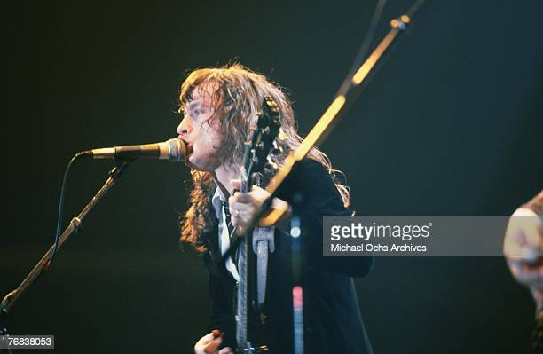Guitarist Angus Young of AC/DC sings backup during a concert on October 18 at the Forum in Inglewood California