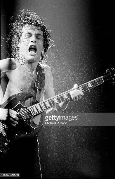 Guitarist Angus Young of Australian rock band AC/DC performing on stage circa 1980