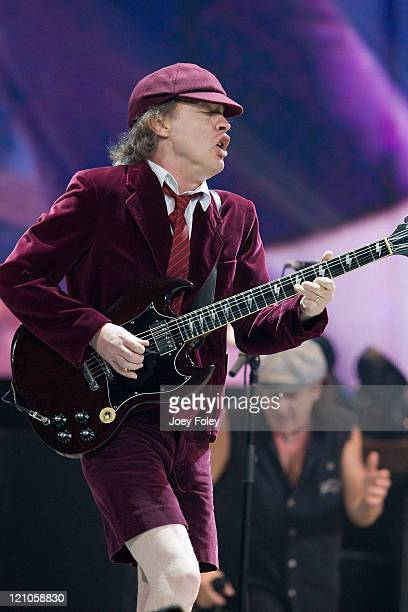 Guitarist Angus Young of the Australian rock band AC/DC performs in concert during their 'Black Ice World Tour' at the Conseco Fieldhouse on November...