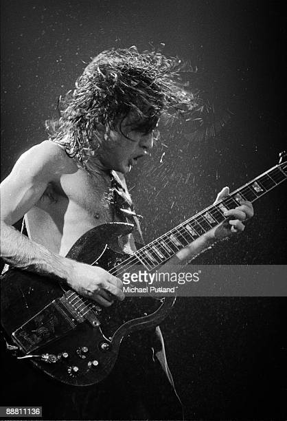 Guitarist Angus Young performing with heavy rock group AC/DC on tour in the UK 1980