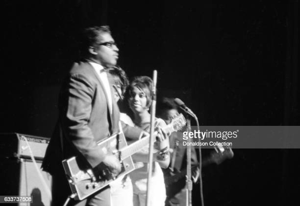 Guitarist Bo Diddley performing at the Apollo Theater with his rectangular shaped Gretsch electric in January 1966 in New York New York