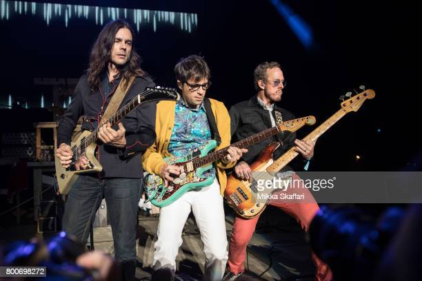 Guitarist Brian Bell vocalist Rivers Cuomo and bassist Scott Shriner of Weezer perform at ID10T festival at Shoreline Amphitheatre on June 24 2017 in...