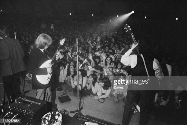 Guitarist Brian Jones and bassist Bill Wyman performing with the Rolling Stones at the Wimbledon Palais London 14th August 1964