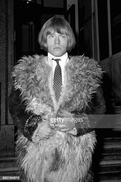 Guitarist Brian Jones of the 'Rolling Stones' alldressed up in London on his way to the Law Courts for his appeal against his nine month sentence...
