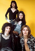Guitarist Brian May singer Freddie Mercury bassist John Deacon and drummer Roger Taylor of British rock band Queen pose in London England in 1973