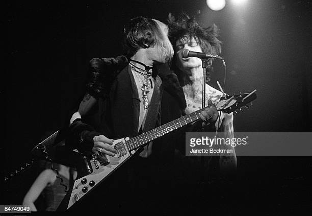 Guitarist Bryan Gregory sings alongside lead singer Lux Interior as The Cramps perform at the Whisky a Go Go in Los Angeles 1981