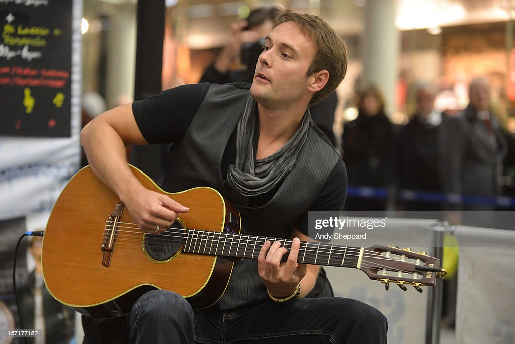 Guitarist Byron Johnston performs as part of the Station Sessions 2012 at St Pancras Station on November 29, 2012 in London, England.