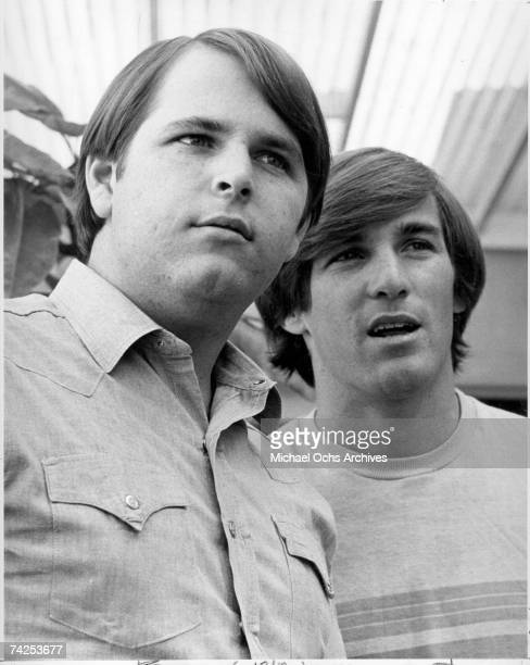 Guitarist Carl Wilson and drummer Dennis Wilson of the rock and roll band 'The Beach Boys' pose for a portrait in circa 1966
