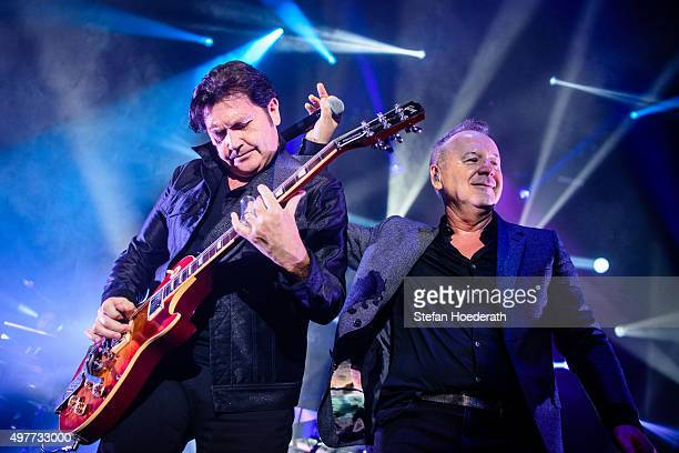 Guitarist Charlie Burchill and singer Jim Kerr of Simple Minds perform live on stage during a concert at Tempodrom on November 18 2015 in Berlin...