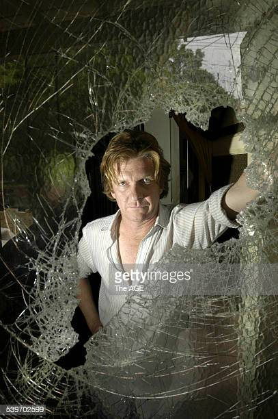 Guitarist Charlie Owen at the front door of his St Kilda house after it was burgled and amongst many stolen items the two most sorely missed are his...