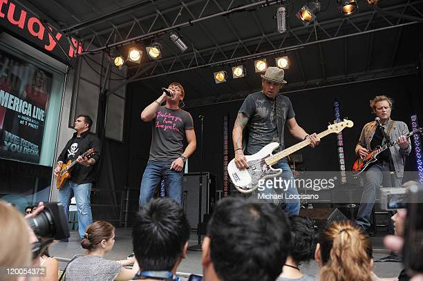 Guitarist Chris Henderson vocalist Brad Arnold bassist Greg Upchurch and guitarist Matt Roberts of Three Doors Down perform on 'FOX and Friends'...