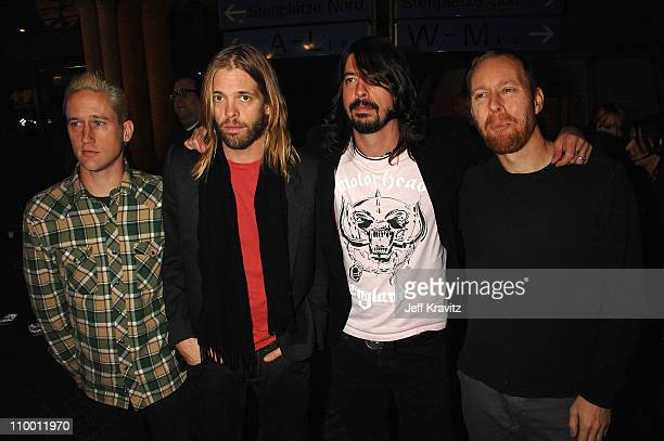 Guitarist Chris Shiflett drummer Taylor Hawkins singer/guitarist Dave Grohl and bassist Nate Mendel of Foo Fighters attend the 2007 MTV Europe Music...