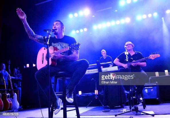 Guitarist Clint Lowery touring keyboardist Kurt Wubbenhorst and bassist Vince Hornsby of Sevendust perform during an acoustic concert at the Marquee...