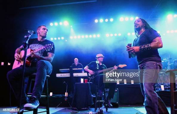 Guitarist Clint Lowery touring keyboardist Kurt Wubbenhorst bassist Vince Hornsby and singer Lajon Witherspoon of Sevendust perform during an...