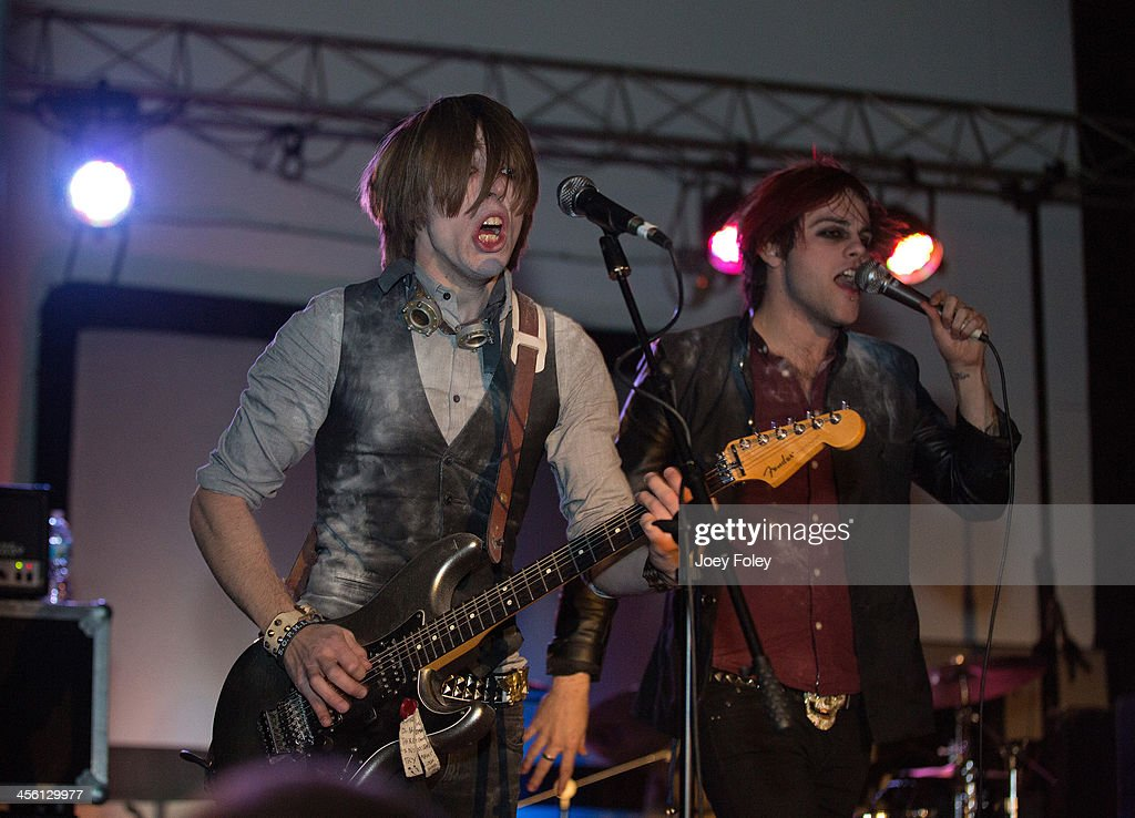 Guitarist Cyrus Barrone (a.k.a. Shane Sumner) and Vocalist Kier Kemp of Fearless Vampire Killers performs at The Emerson Theater on November 30, 2013 in Indianapolis, Indiana.