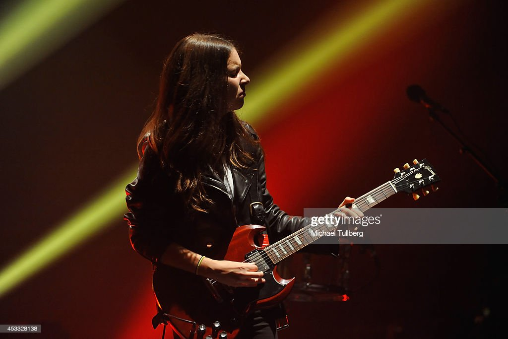 Guitarist <a gi-track='captionPersonalityLinkClicked' href=/galleries/search?phrase=Danielle+Haim&family=editorial&specificpeople=2499485 ng-click='$event.stopPropagation()'>Danielle Haim</a> of the rock group HAIM performs at Wiltern Theatre on August 7, 2014 in Los Angeles, California.