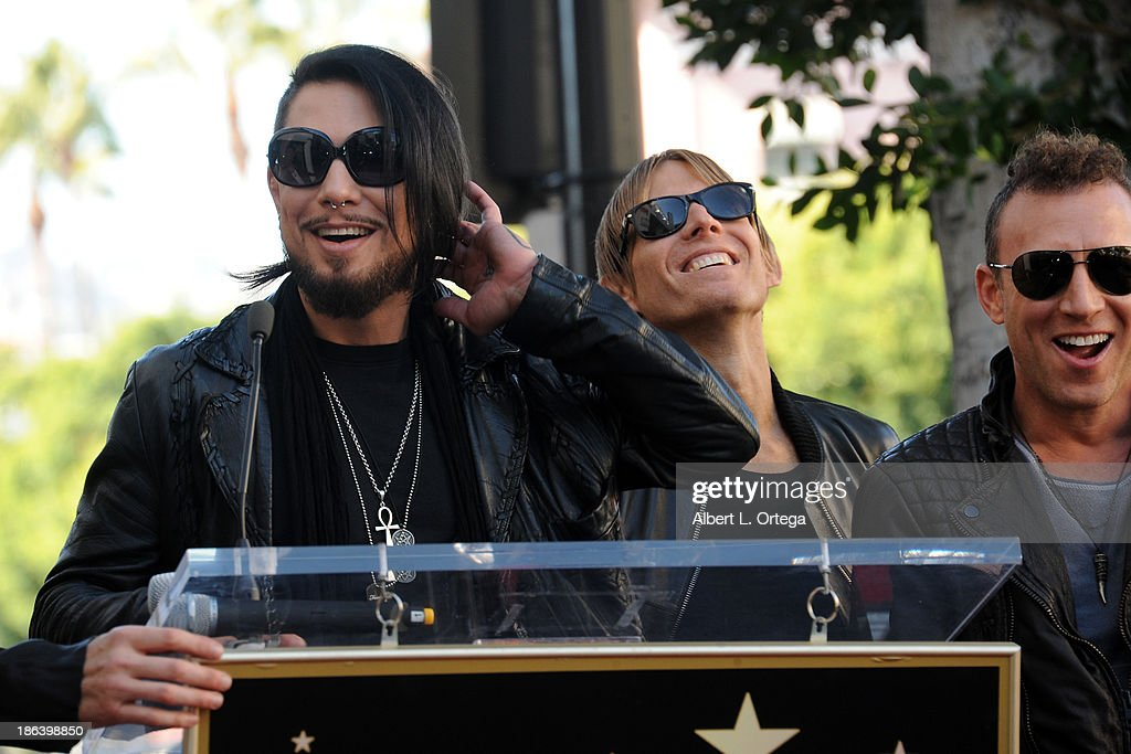 Guitarist Dave Navarro, bassist Chris Chaney and drummer Stephen Perkins at Jane's Addiction Star On The Hollywood Walk Of Fame Ceremoney on October 30, 2013 in Hollywood, California.