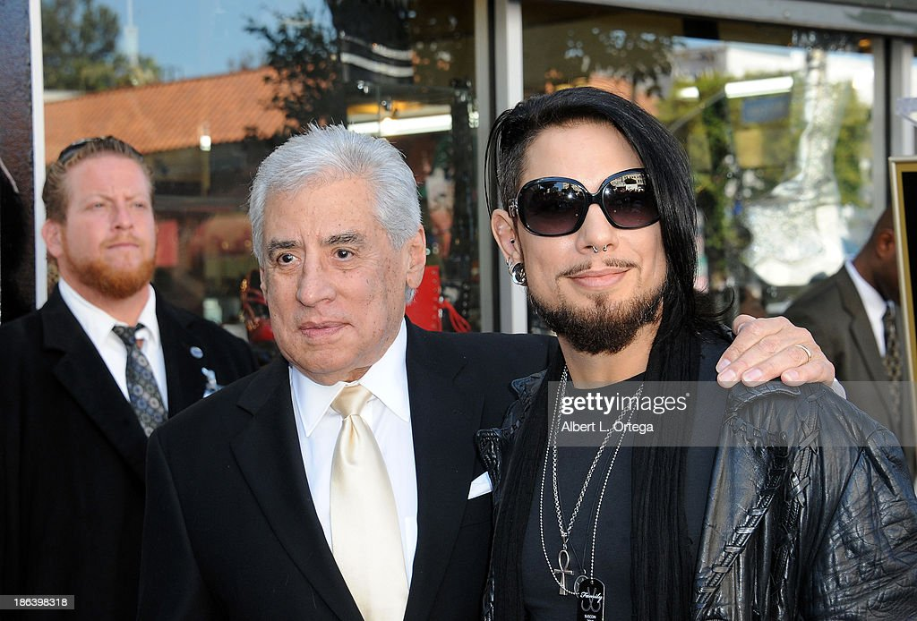 Guitarist <a gi-track='captionPersonalityLinkClicked' href=/galleries/search?phrase=Dave+Navarro&family=editorial&specificpeople=202159 ng-click='$event.stopPropagation()'>Dave Navarro</a> with father at Jane's Addiction Star On The Hollywood Walk Of Fame Ceremoney on October 30, 2013 in Hollywood, California.